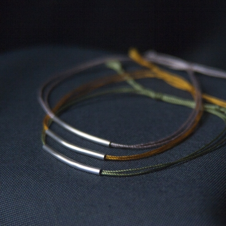 sterling silver and silk bracelet